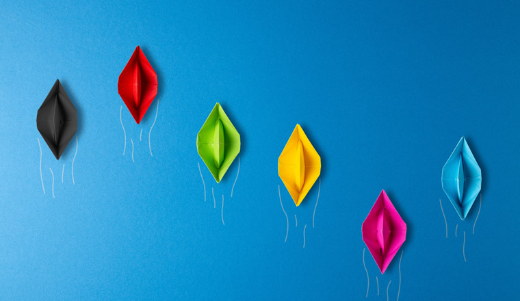 Bundestagswahl 2021 paper boat concept. boats in colors of the german big political parties in competiton for the germany election on blue background